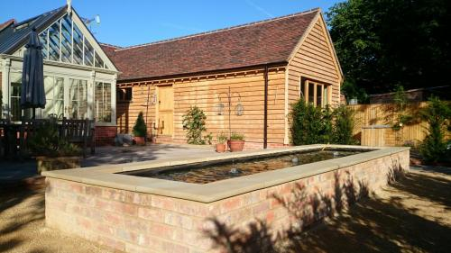 Brick ponds can sit beautifully in a garden setting