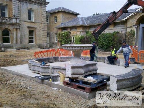 Installation of the fountain surround stones