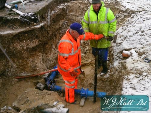 Large bore burst pipe repair in progress